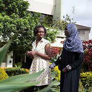 Caroline Oloo, 21(on the left). Caroline is a Nairobits graduate and now works in a web design company as an instructional / user interface designer. She still lives in the slums with her family. Rukia Sebit is Project coordinator at Nairobits and former teacher of Caroline. Nairobits is a charity teaching kids from Nairobi's slums IT and train them to get work in the IT sector.Every year 1mill young people graduate and leave school and only 1/3 have any hope of getting a job. Nairobits aim to train more than 500 young people / year from the slums, some with only basic formal education, how to set up their own business or get a job in the growing IT sector in Kenya.