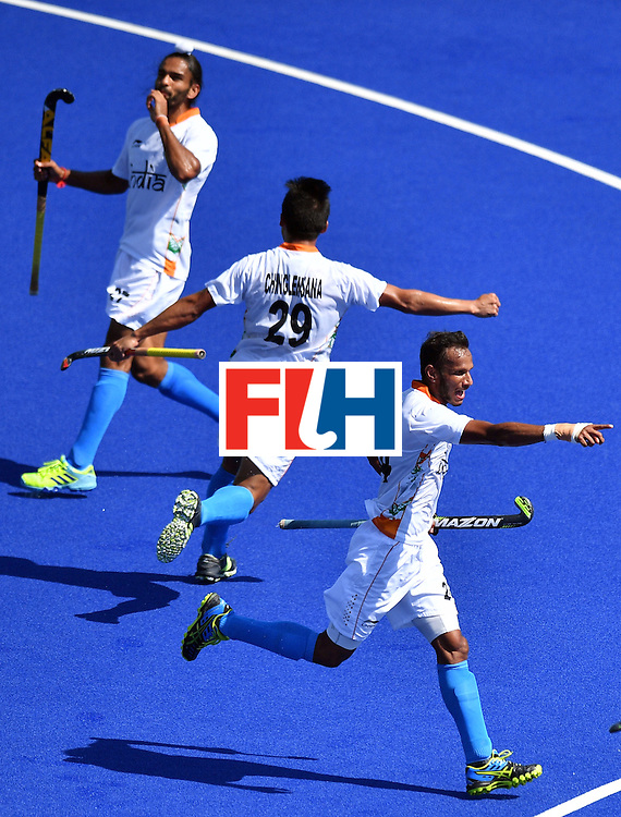 India's Chinglensana Kangujam (R), India's Akashdeep Singh (L) and India's Sunil Sowmarpet celebrate a goal during the men's quarterfinal field hockey Belgium vs India match of the Rio 2016 Olympics Games at the Olympic Hockey Centre in Rio de Janeiro on August 14, 2016. / AFP / Carl DE SOUZA        (Photo credit should read CARL DE SOUZA/AFP/Getty Images)
