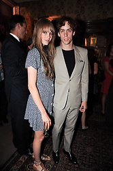 Singer JOHNNY BORRELL and EDIE CAMPBELL at a party to celebrate the publication of Imperial Bedrooms by Bret Easton Ellis held at Mark's Club, 46 Charles Street, London W1 on 15th July 2010.