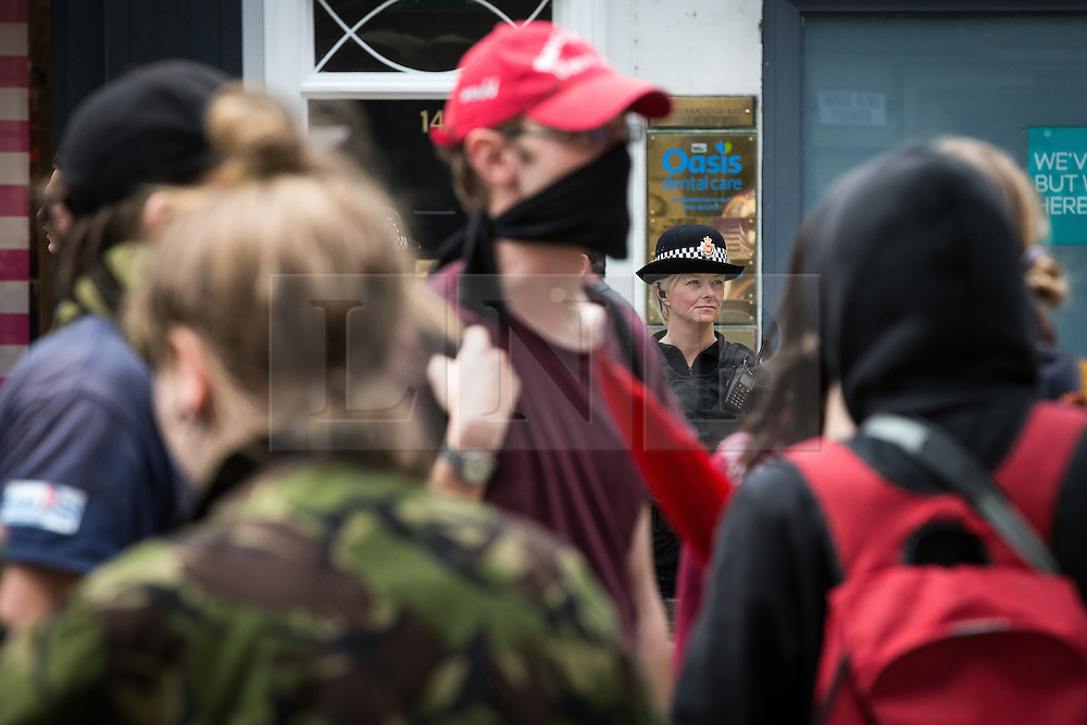 "© Licensed to London News Pictures . 23/05/2015 . Manchester , UK . A group of protesters peel away from the Piccadilly Gardens and march impromptu through St Anne's Square . A demonstration , organised by "" The People's Assembly "" , against austerity in Piccadilly Gardens in Central Manchester , attended by approximately 2000 people . Photo credit : Joel Goodman/LNP"