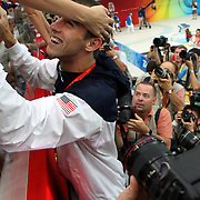 Michael Phelps greets family members in the stands after the men's 4 x 100m medley relay swimming final medal ceremony at the National Aquatics Center during the 2008 Beijing Olympic Games in Beijing on August 17, 2008...
