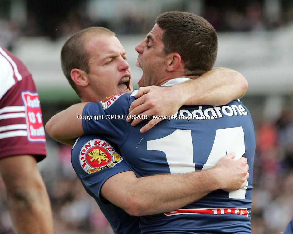 Grant Rovelli celebrates with George Gatis.<br />