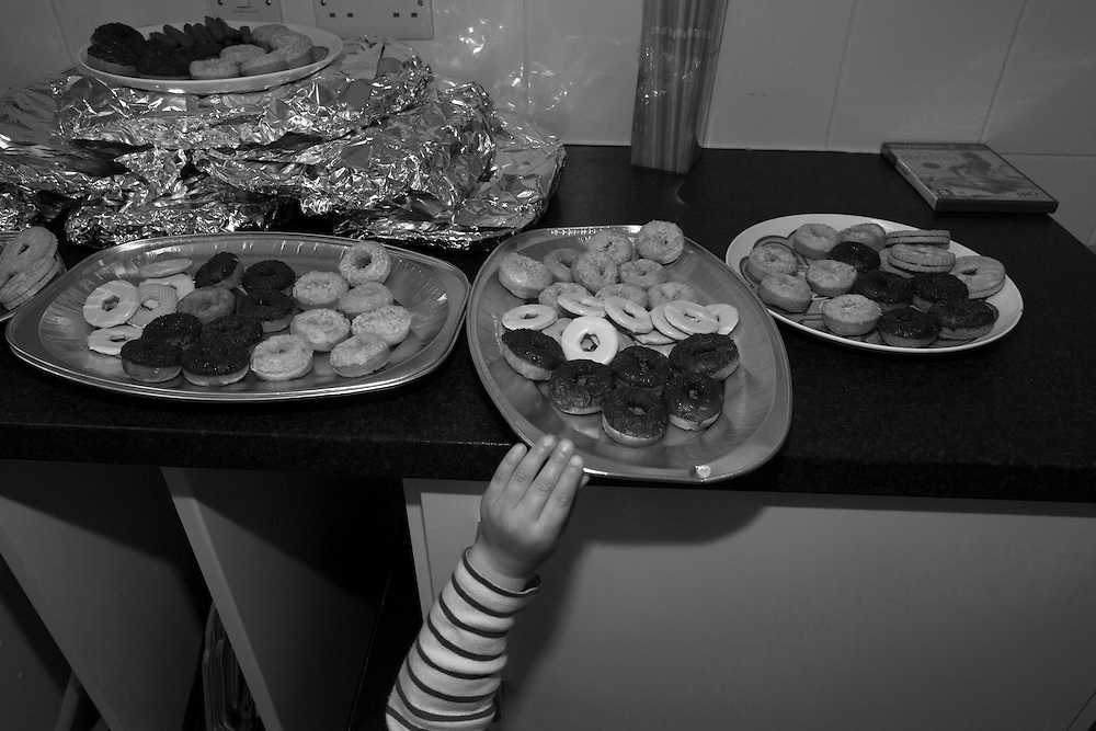 Joe tries to get his hands on the biscuit tray during a party in Berkhamsted Saturday, April 18, 2015 (Elizabeth Dalziel) #thesecretlifeofmothers #bringinguptheboys #dailylife