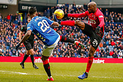 Alfredo Morelos & Youssouf Mulumbu of Kilmarnock challenge for the ball during the Ladbrokes Scottish Premiership match between Rangers and Kilmarnock at Ibrox, Glasgow, Scotland on 16 March 2019.