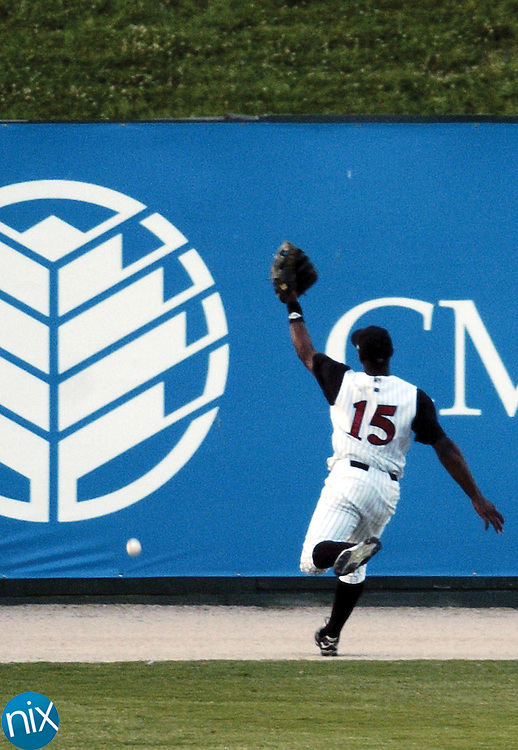 Kannapolis' Sergio Morales cannot catch a ball hit deep to center field by the West Virginia Power Wednesday night.