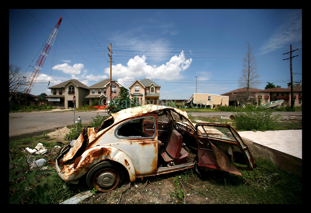 May 29th, 2006. New Orleans, Louisiana. Memorial Day. A rusted and rotting, once flooded VW Beetle remains in the wreckage close to the 17th Street canal where the levee breached during Hurricane Katrina, destroying the once affluent, predominantly white neighbourhood.
