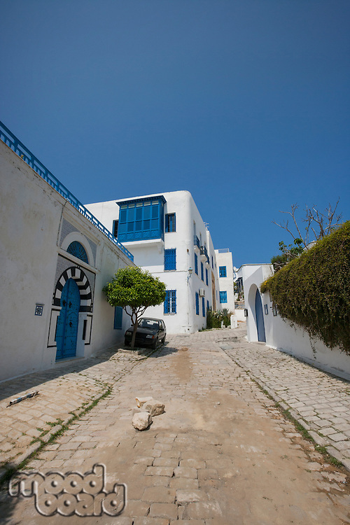 View of street and residential building against clear blue sky; Tunis; Tunisia