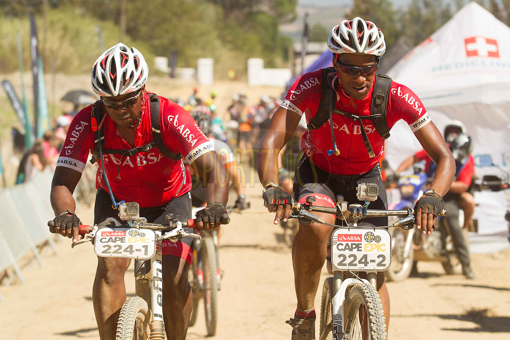 Andre Ross and Gugu Zulu during stage 5 of the 2013 Absa Cape Epic Mountain Bike stage race held from Wellington, South Africa on the 22 March 2013..Photo by Greg Beadle/Cape Epic/SPORTZPICS