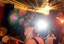 30 Sept, 2005. New Orleans, Louisiana. Hurricane Katrina aftermath.<br /> Music returns to the city at the infamous Maple Leaf bar in Uptown New Orleans. Legendary local jazz man Walter 'The Wolfman' Washington (left) plays to residents, some of whom fled the storm and others who rode it out.<br /> Photo; ©Charlie Varley/varleypix.com