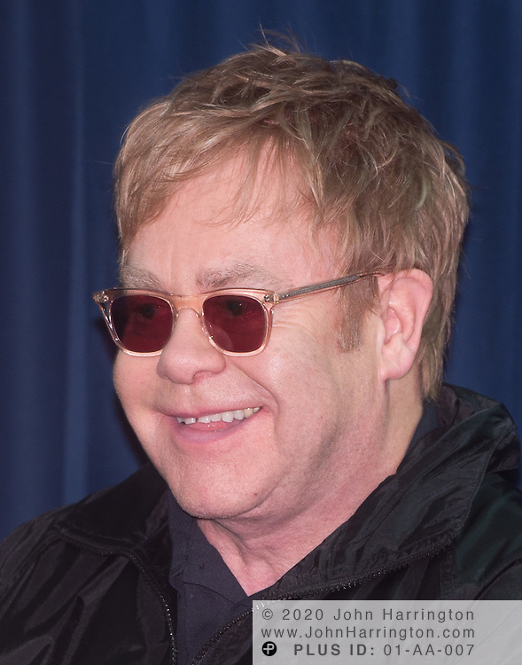 Sir Elton John speaks at the 2010 WTT Smash Hits charity event which brought together several of the top names in tennis to raise money for the Elton John AIDS Foundation and the Washington AIDS Partnership at American University on November 15th, 2010. Sir Elton John captained and competed with a team that included Martina Navratilova, Jan-Michael Gambill, Anna Kournikova, and Andre Agassi.