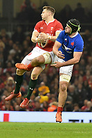 Football - 2020 Guinness Six Nations Championship - Wales vs. France<br /> <br /> Dan Biggar, of Wales leaps for the ball with Gregory Alldritt of France, at the Principality (Millennium) Stadium.<br /> <br /> COLORSPORT/WINSTON BYNORTH