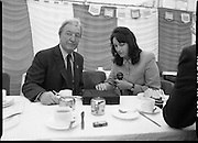 Charles Haughey Visits The Community Games. (T5)..1989..03.10.1989..10.03.1989..3rd September 1989..An Taoiseach, Charles Haughey TD,accompanied by Mr Frank Fahey, TD, Minister of State with responsibility for Youth and Sport attended the Twentieth National Finals of the Community Games at Mosney,  Co.Meath yesterday...An Taoiseach is pictured being interviewed for radio as he has his tea. Do you know the reporter, why not let us know at irishphotoarchive@gmail.com  and we will gladly add the name.