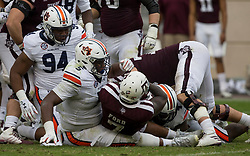 Texas A&M running back Keith Ford (7) is stopped for a loss by Auburn defensive lineman Derrick Brown (5) and defensive lineman Tyrone Truesdell (94) during the first quarter of an NCAA college football game on Saturday, Nov. 4, 2017, in College Station, Texas. (AP Photo/Sam Craft)