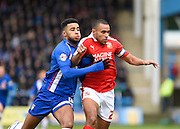 Gillingham forward Dominic Samuel fights for the ball with Swindon defender Nathan Thompson during the Sky Bet League 1 match between Gillingham and Swindon Town at the MEMS Priestfield Stadium, Gillingham, England on 6 February 2016. Photo by David Charbit.
