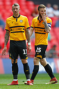 Newport County defender Scot Bennett (17) and Newport County defender Mark O'Brien (25) during the EFL Sky Bet League 2 Play Off Final match between Newport County and Tranmere Rovers at Wembley Stadium, London, England on 25 May 2019.