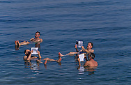 = people floting and reading on the salted sea . Dead sea,     - Israel   +