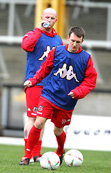 SWANSEA, WALES - TUESDAY MARCH 22nd 2005: Wales' Gavin Williams and John Hartson during training at Swansea City's Vetch Field Stadium. (Pic by David Rawcliffe/Propaganda)