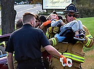 A firefighter rescues a young child in a car seat after an accident on the San Souci. 10/21/2015 Aimee Dilger|Times Leader