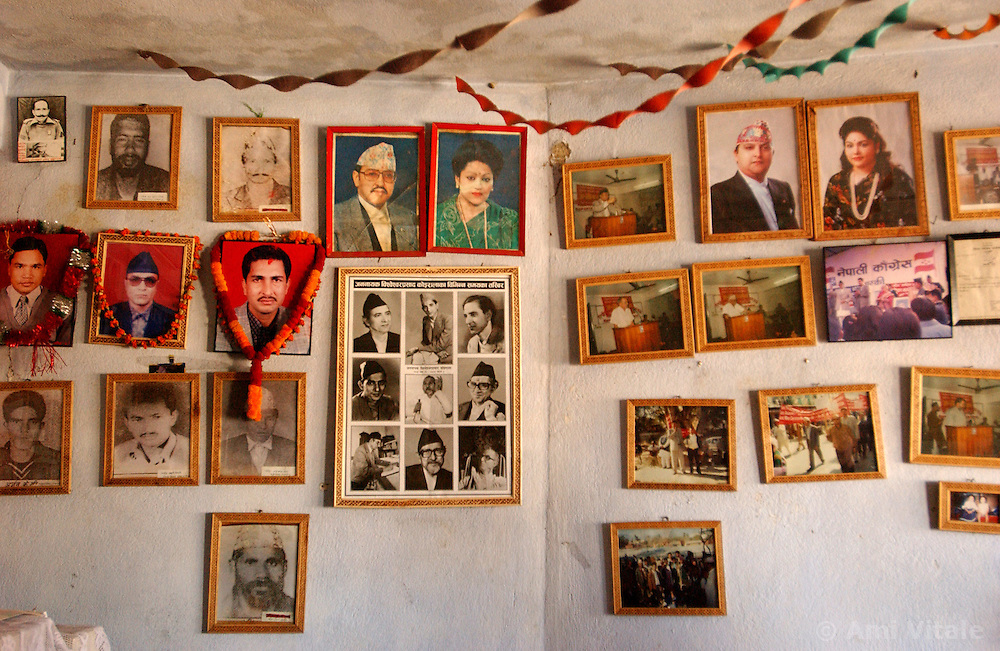 Photographs of martyrs who were killed by Maoists hang next to pictures of the deceased King and Queen of Nepal who were shot by their son as well as photographs of the current King and Queen inKathmandu, Nepal March 6, 2005.   The conflict between government troops and the Maoist insurgents has claimed over 11,000 lives since 1996. (Ami Vitale)