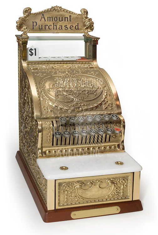 Vintage brass cash register isolated on white with clipping path