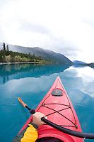 Kayaking on Chilko Lake. BC, Canada.
