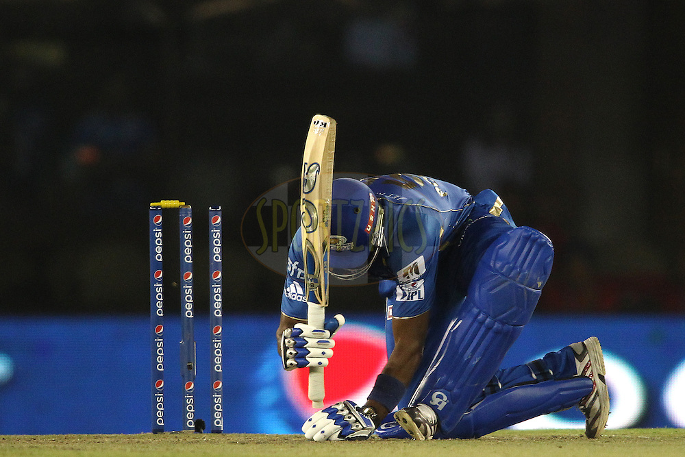 Kieron Pollard of the Mumbai Indians marks his guard during match 48 of the Pepsi Indian Premier League Season 2014 between the Kings XI Punjab and the Mumbai Indians held at the Punjab Cricket Association Stadium, Mohali, India on the 21st May  2014<br /> <br /> Photo by Shaun Roy / IPL / SPORTZPICS<br /> <br /> <br /> <br /> Image use subject to terms and conditions which can be found here:  http://sportzpics.photoshelter.com/gallery/Pepsi-IPL-Image-terms-and-conditions/G00004VW1IVJ.gB0/C0000TScjhBM6ikg