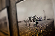 A family photograph hangs in Mitchell Baalman's office on his family's 12,000-acre farm outside of Hoxie, Kan., on Thursday, Oct. 11, 2012. As historically dry conditions continue, farmers from South Dakota to the Texas panhandle rely on the Ogallala Aquifer, the largest underground aquifer in the United States, to irrigate crops. After decades of use, the falling water level ? accelerated by historic drought conditions over the last two years ? is putting pressure on farmers to ease usage or risk becoming the last generation to grow crops on the land. Farmers like Mitchell Baalman and Brett Oelke (not pictured), are part of a farming community in in Sheridan County, Kansas, an agricultural hub in western Kansas, who have agreed to cut back on water use for crop irrigation so that their children and future generations can continue to farm and sustain themselves on the High Plains.