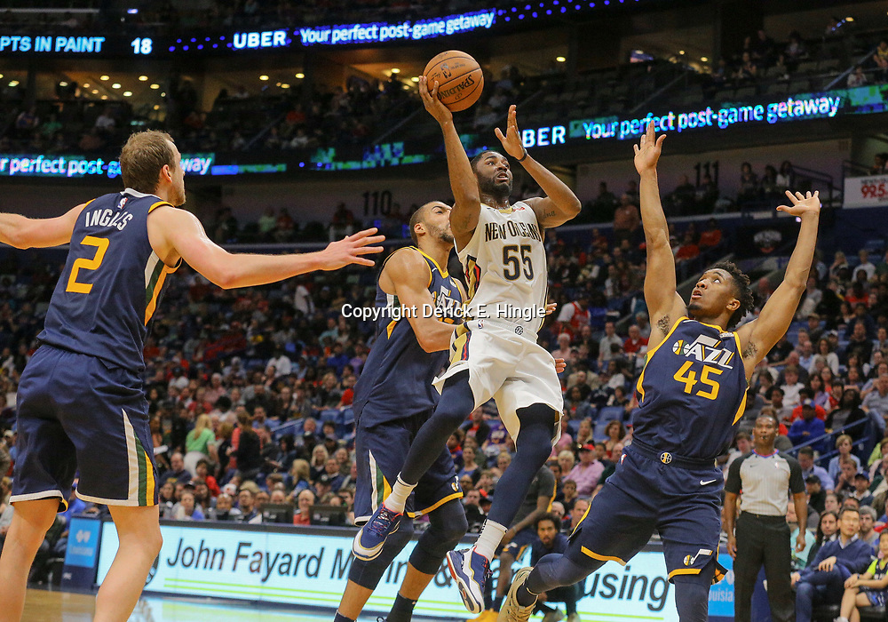 Mar 11, 2018; New Orleans, LA, USA; New Orleans Pelicans forward E'Twaun Moore (55)  shoots over Utah Jazz forward Joe Ingles (2) and center Rudy Gobert (27) and guard Donovan Mitchell (45) during the first half at the Smoothie King Center. Mandatory Credit: Derick E. Hingle-USA TODAY Sports