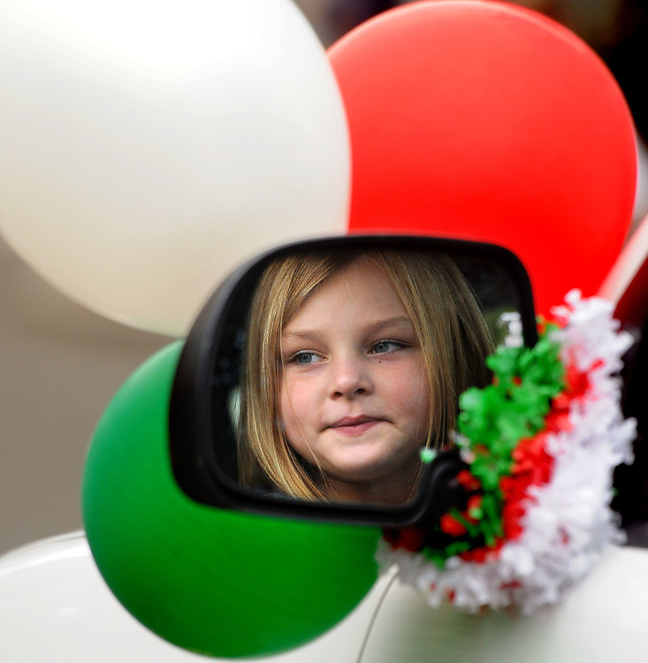 (Mara Lavitt &mdash; New Haven Register) <br /> October 13, 2013 Branford<br /> The Greater New Haven Area Columbus Day Parade rotates between six towns. This year it was in Branford. Scarlett Vernucci age 6 of Fairfield, reflected in the truck mirror she rode in the parade.