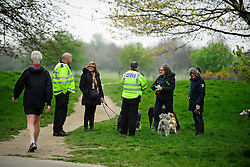 © London News Pictures. 22/04/2016. London, UK. British police talk to dog walkers in Regents Park as heightened security surrounds the residence of the US Ambassador to the United Kingdom in Regents Park, London, where the President of the United States Barak Obama is staying during his visit to the UK. Photo credit: Ben Cawthra/LNP