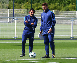 September 12, 2017 - Enfield, Greater London, United Kingdom - L-R Assistant head coach Jesús Pérez and Tottenham Hotspur manager Mauricio Pochettino .during a Tottenham Hotspur training session ahead of the UEFA Champions League Group H match against Borussia Dortmund  at Tottenham Hotspur Training centre on 12 Sept , 2017 in Enfield, England. (Credit Image: © Kieran Galvin/NurPhoto via ZUMA Press)