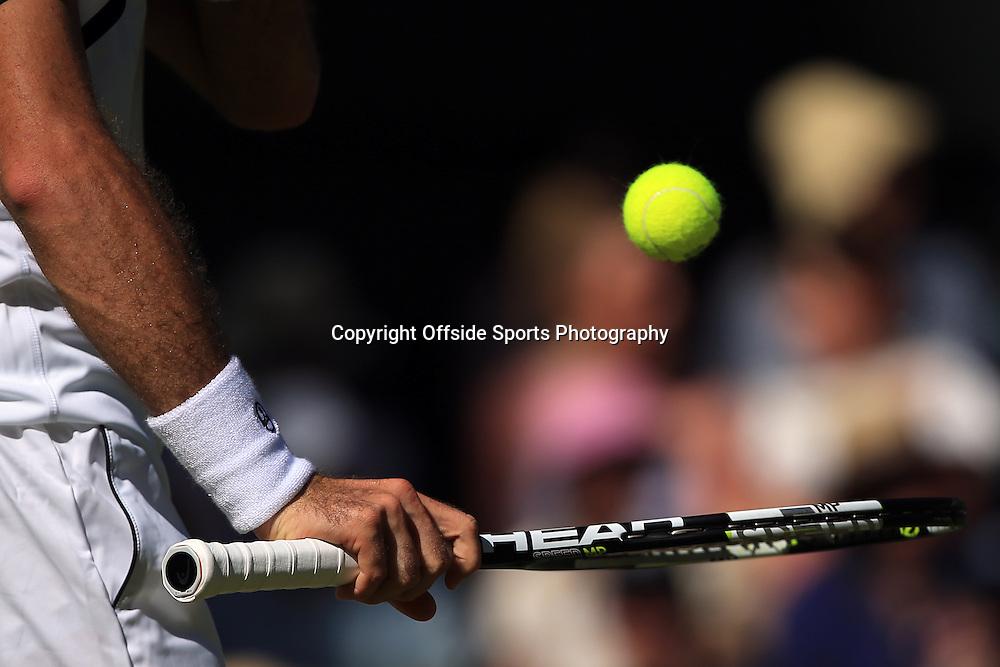 30 June 2015 - Wimbledon (Day 2) - Detail of HEAD tennis racket and tennis ball - Photo: Marc Atkins / Offside.