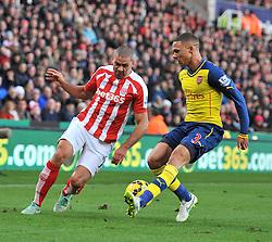Stoke's Jonathan Walters attempts to pass Arsenal's Kieran Gibbs - Photo mandatory by-line: Dougie Allward/JMP - Mobile: 07966 386802 - 06/12/2014 - SPORT - Football - Stoke - Britannia Stadium - Stoke City v Arsenal - Barclays Premie League