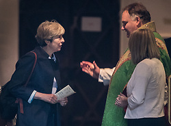 © Licensed to London News Pictures. 03/09/2017. Reading, UK.  Prime Minister Theresa May talks with Vicar, The Reverend Jamie Taylor, as she attends church. Mrs May is facing pressure from back bench Conservative MPs over the EU repeal bill which is to be debated later this week as Parliament returns from the summer break. Photo credit: Peter Macdiarmid/LNP