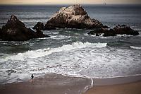 Man fishes Ocean Beach. San Francisco, CA. Copyright 2017 Reid McNally.