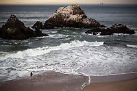 Man fishes Ocean Beach. San Francisco, CA. Copyright 2017 Reid McNally.