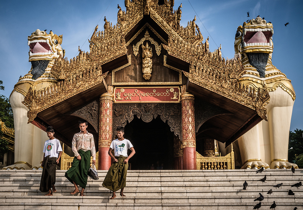 Young boys leaving Shwedagon Pagoda in Yangon. Shwedagon Pagoda is the most sacred Buddhist pagoda in Myanmar, as it is believed to contain relics of the four previous Buddhas of the present kalpa, the period of time between the creation and recreation of a world or universe.