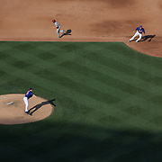Pitcher Matt Harvey, New York Mets, pitching as A.J. Pollock, Arizona Diamondbacks, sets off on a failed steal attempt from first base during the New York Mets Vs Arizona Diamondbacks MLB regular season baseball game at Citi Field, Queens, New York. USA. 11th July 2015. Photo Tim Clayton
