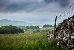© Licensed to London News Pictures. 26/06/2015. Langcliffe.UK. Britain is set for a heat wave next week but for now the rain clouds are gathering over Langcliffe in the Yorkshire Dales. Photo credit : Andrew McCaren/LNP