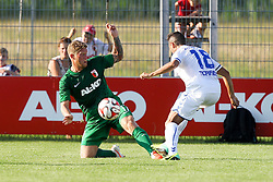 18.07.2014, Sportplatz Jettingen, Jettingen, GER, FS Vorbereitung, Karlsruher SC vs FC Augsburg, im Bild l-r: im Zweikampf, Aktion, mit Marcel De Jong #17 (FC Augsburg) und Manuel Torres #18 (Karlsruher SC) // during a Friendly Match between Karlsruher SC and FC Augsburg at the Sportplatz Jettingen in Jettingen, Germany on 2014/07/18. EXPA Pictures © 2014, PhotoCredit: EXPA/ Eibner-Pressefoto/ Kolbert<br /> <br /> *****ATTENTION - OUT of GER*****