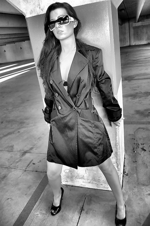 Young woman posing in parking garage in a fantasy setting.