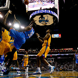 December 10, 2010; New Orleans, LA, USA; Oklahoma City Thunder forward Kevin Durant (35) shoots over New Orleans Hornets center Emeka Okafor (50) during the first half at the New Orleans Arena.  Mandatory Credit: Derick E. Hingle-US PRESSWIRE