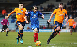 Jack Marriott of Peterborough United is tacked by Kean Bryan and Anthony Gerrard of Oldham Athletic - Mandatory by-line: Joe Dent/JMP - 20/01/2018 - FOOTBALL - ABAX Stadium - Peterborough, England - Peterborough United v Oldham Athletic - Sky Bet League One