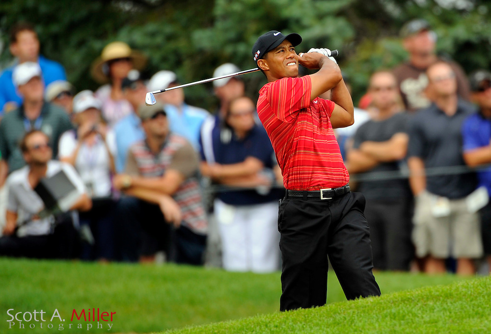 Aug 16, 2009; Chaska, MN, USA; Tiger Woods (USA) hits out of a bunker on the third hole during the final round of the 2009 PGA Championship at Hazeltine National Golf Club.  ©2009 Scott A. Miller