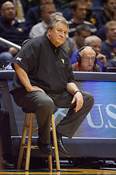 Jan 20, 2016; Morgantown, WV, USA; West Virginia Mountaineers head coach Bob Huggins sits on a stool during the second half against the Texas Longhorns at the WVU Coliseum. Mandatory Credit: Ben Queen-USA TODAY Sports