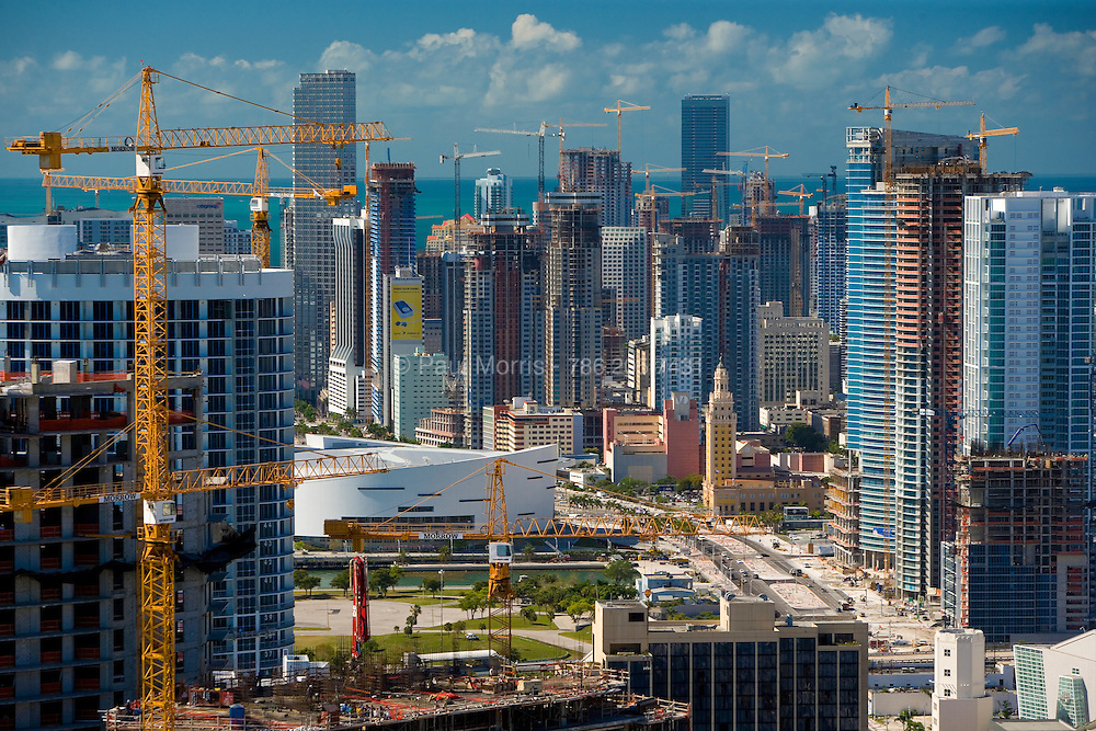 Aerial of the downtown Miami skyline showing the multitude of construction cranes and development dwarfing the 1925 Freedom Tower.