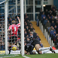 Photo: Lee Earle.<br /> Portsmouth v Sheffield United. The Barclays Premiership. 23/12/2006. United's Rob Hulse (L) turns away to celebrate his opening goal as Portsmouth keeper David James is beaten.