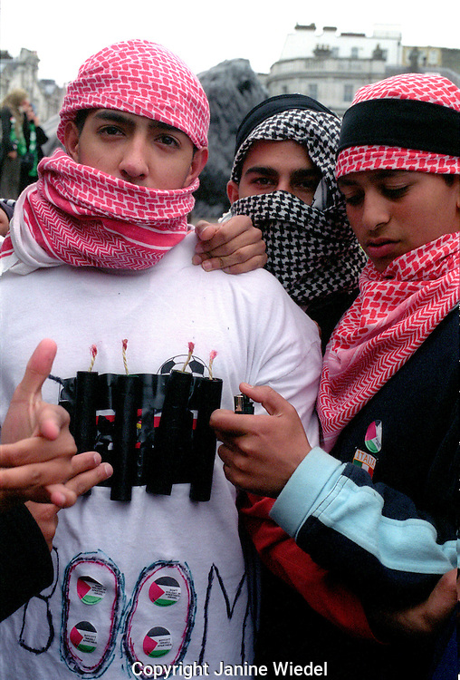 Young Palestinian boy with fake suicide bomb at protest march 2002.