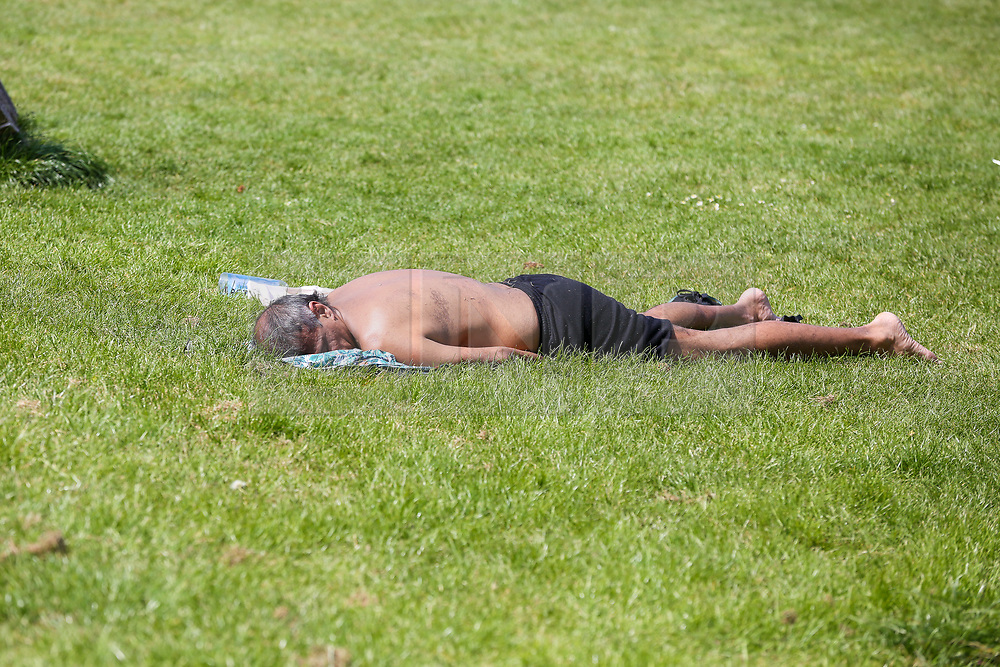 © Licensed to London News Pictures. 09/05/2020. London, UK. A man sunbathes in Finsbury Park, north London on what could be he hottest day of the year so far. Prime Minister Boris Johnson is set to announce on Sunday, 10 May, measures to ease coronavirus lockdown, which was introduced on 23 March to slow the spread of the COVID-19. Photo credit: Dinendra Haria/LNP