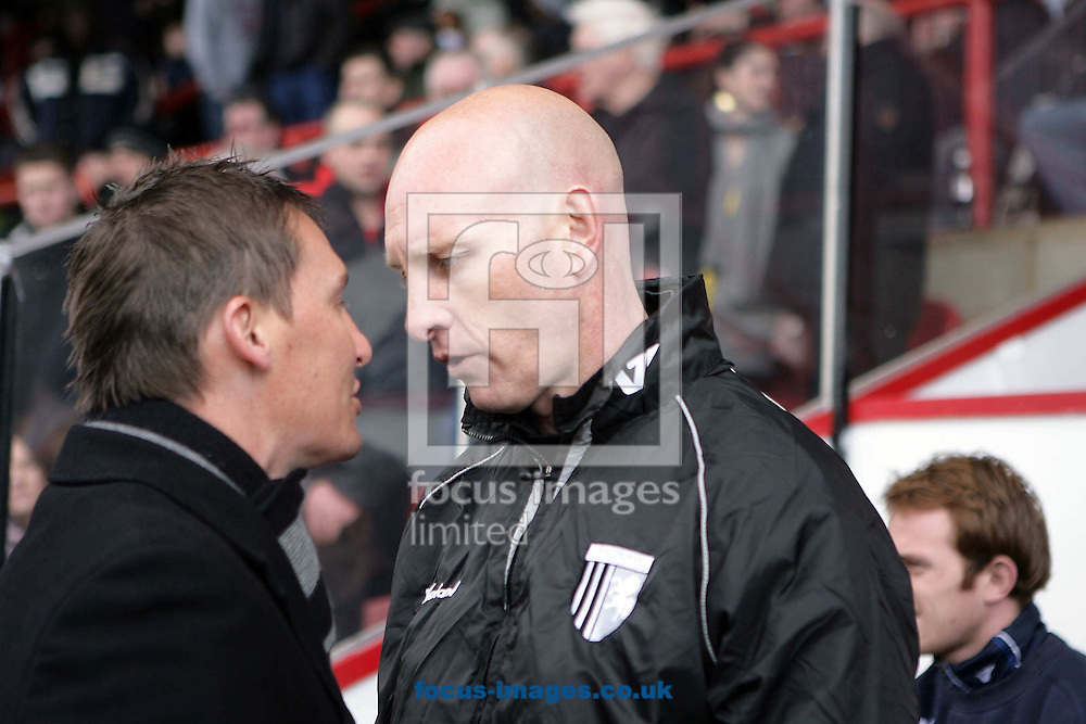 London - Saturday, March 28th, 2009: Gillingham manager Paul Stimson (L) confronts Brentford manager Andy Scott due to Stimson blaming Scott's involvement in the F.A.' s decision to ban Gillingham defender Garry Richards three game ban after the two sides met in December 2008 during the Coca Cola League Two match at Griffin Park, London. (Pic by Mark Chapman/Focus Images)